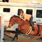 Danielle training her horse in front of our house (Danielle entrenando su caballo enfrente de la casa)